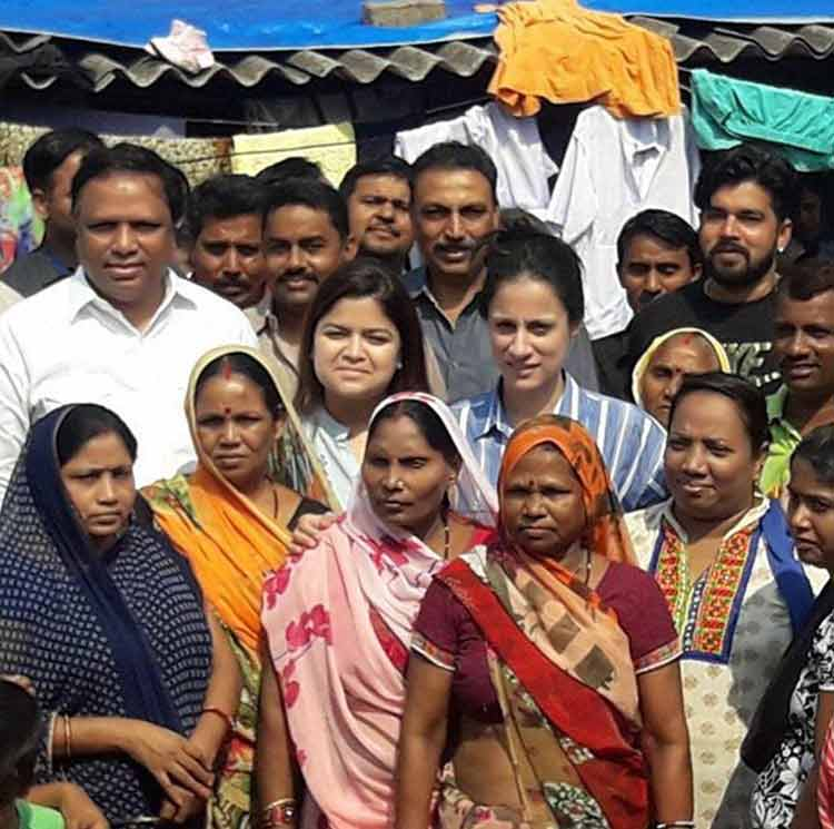 Rouble interacts with the slum dwellers and women to spread awareness about cleanliness and hygiene